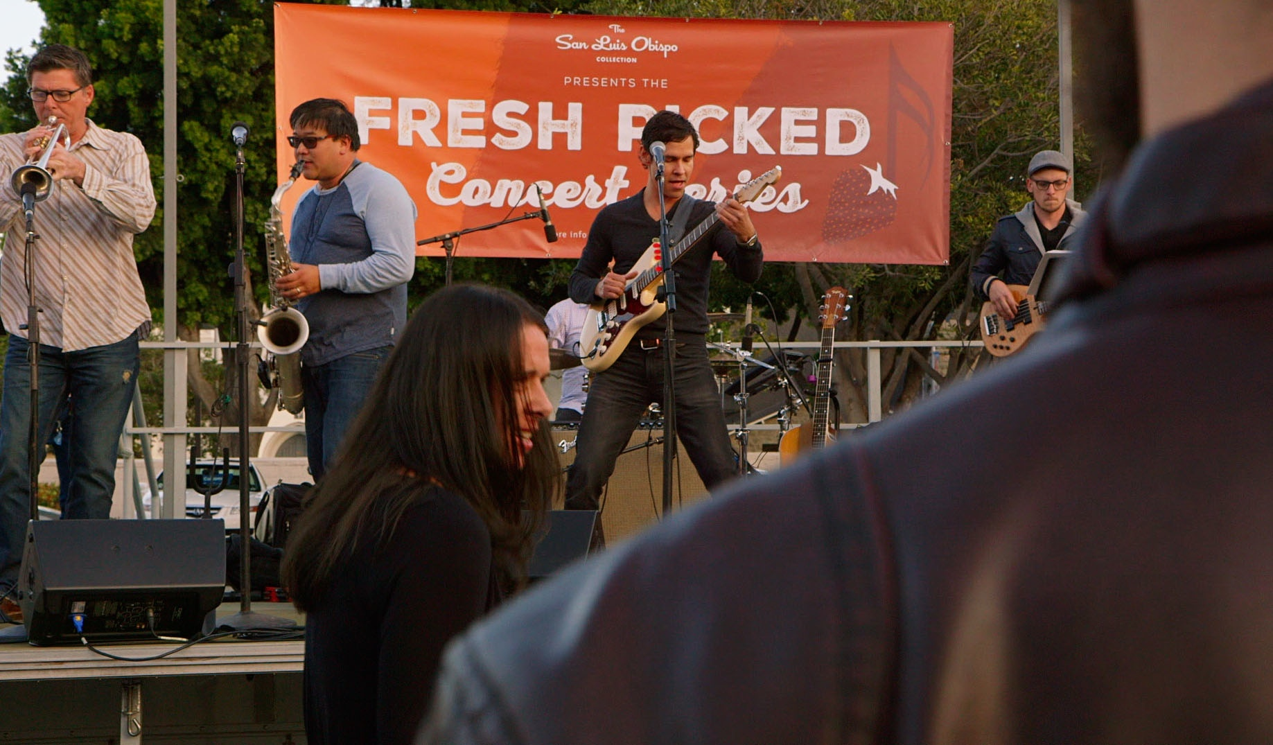 Band playing live music on stage at the Fresh Picked Concert Series