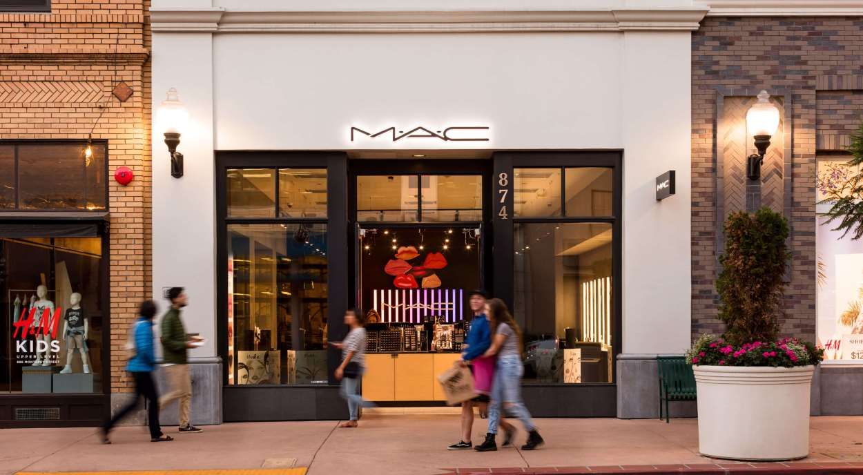 MAC storefront with pedestrians on sidewalk